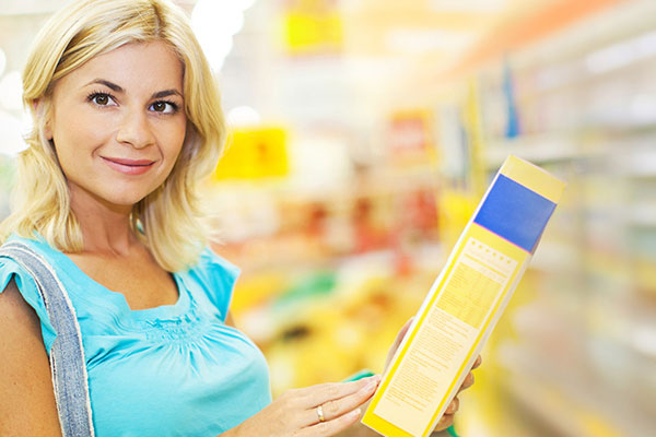 Female shopper in supermarket aisle