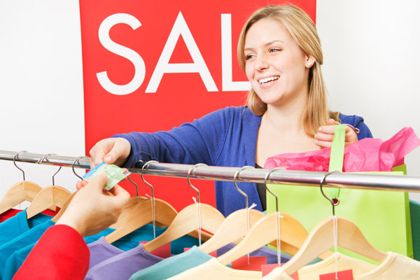 Female customer buying clothes in sale