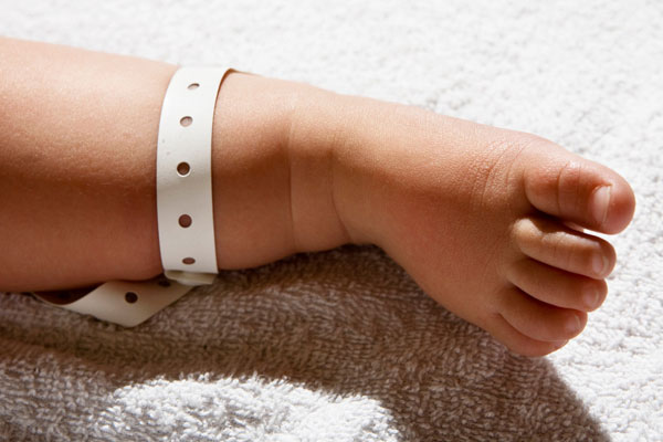 Wristband on baby's ankle