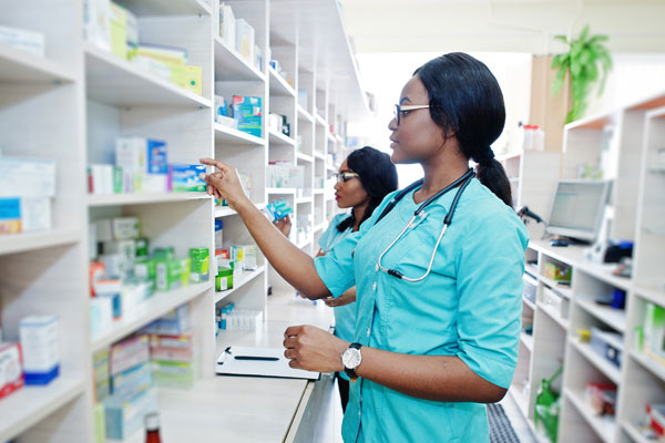 Pharmacy staff checking stock